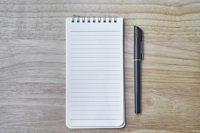 a notepad and pen for starting your own op-ed